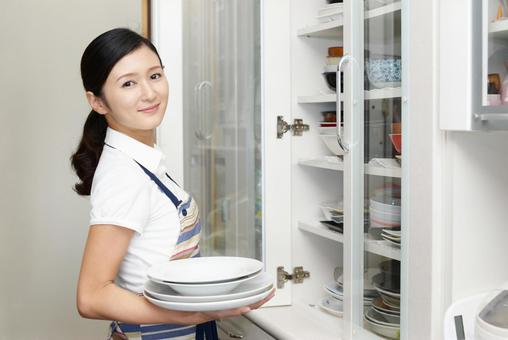 Smile woman with tableware
