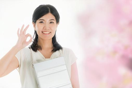 Image of spring with a woman holding a laptop