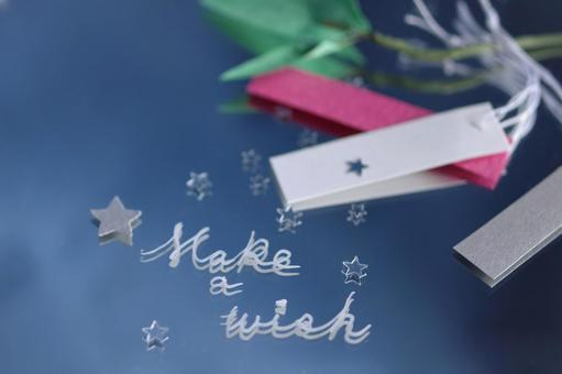 """The letters """"Make a wish"""" (English) written on the mirror and a strip of Tanabata"""