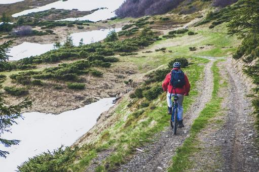 Male who goes by mountain path by bicycle 7