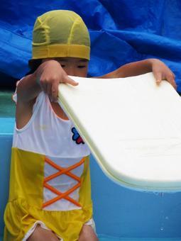 Girl practicing swimming