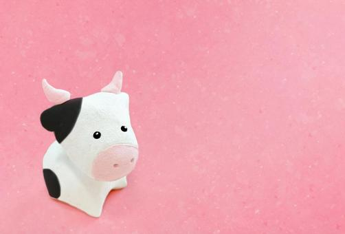 Pink Japanese paper and cow figurine