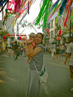 Mother and daughter taking a commemorative photo at the Tanabata Festival