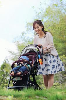 Walking mother while taking a child