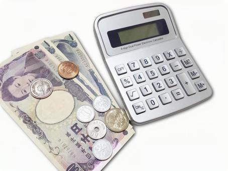 Bills, calculators and coins 0125