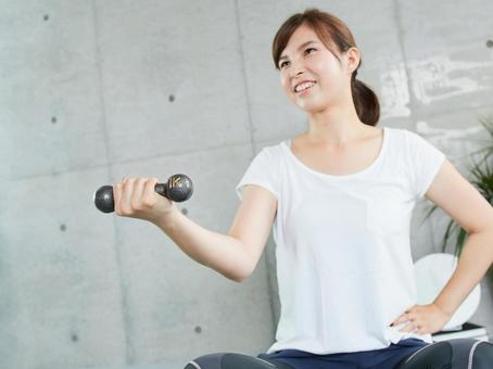 Japanese woman doing dumbbell training at home