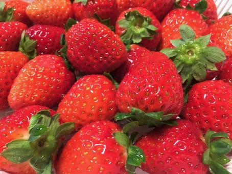 Bright red strawberry (cake making)