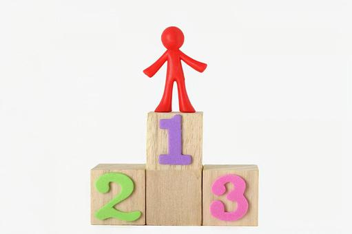 A doll stands on the podium 1
