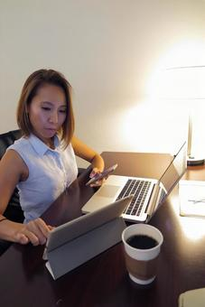 Woman working in a hotel room