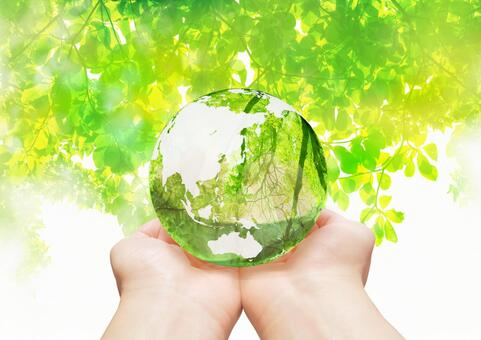 Putting the global environment in the palm of your hand-green abstract background