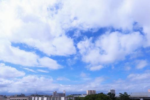 Beautiful gentle autumn sky with clouds floating in the blue sky