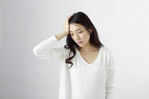 Japanese women suffering from headache 1