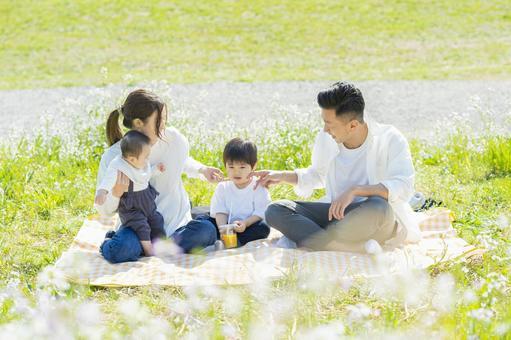 Parents and children enjoying a picnic