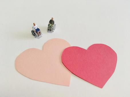 Elderly people in wheelchairs and hearts (image of long-term care)