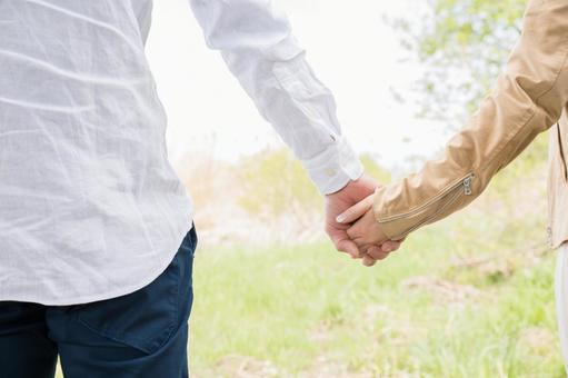 A man holding hands