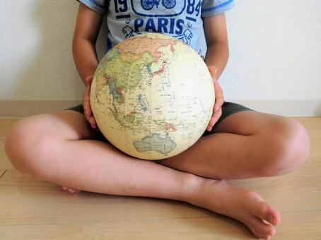 Children holding a globe (SDGs)