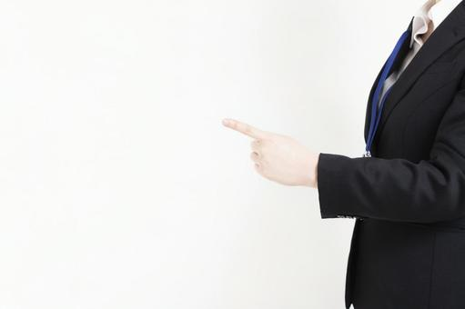 Business woman pointing at business point