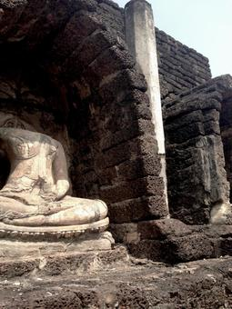 Buddha statue without head in the ruins of Thailand
