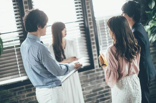 Company employee standing by window and meeting