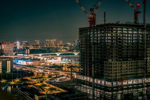 Condominium under construction and night view (Toyosu)