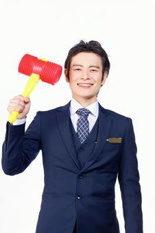Hotel Man with Pico Pico Hammer