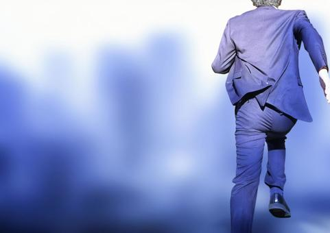 Back view of a businessman running in a blue city