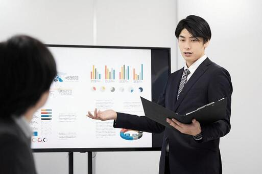Japanese male businessman giving a presentation