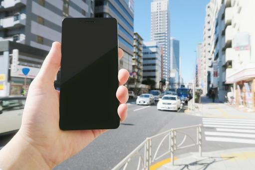 Cityscape with the hand of a man walking smartphone