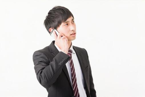 A businessman who places a mobile phone in his ear 3