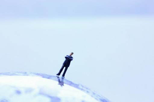 Miniature businessman globe 11