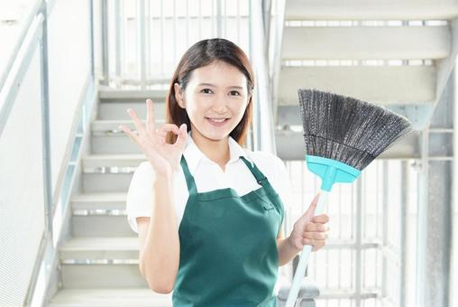 A smiling housewife giving an OK sign