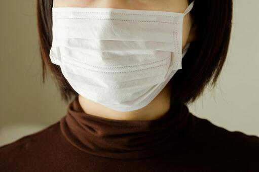 Women wearing hygiene masks to prevent hay fever, colds, flu and viral infections