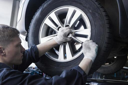 Automobile mechanic servicing tires 9