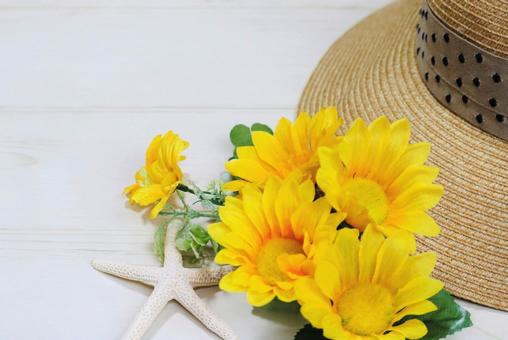 Flowers and straw hat