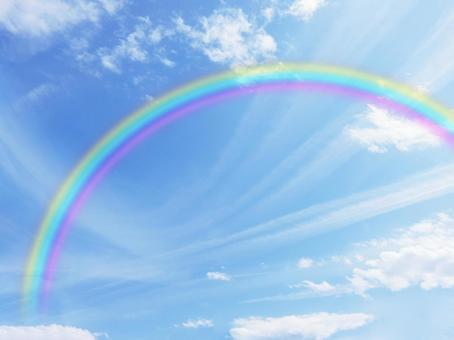 Rainbow and blue sky and clouds