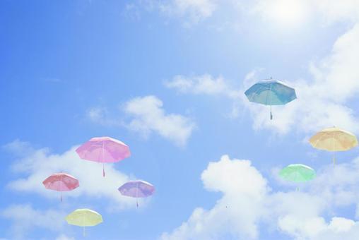 Blue sky background image of vinyl umbrella floating in colorful sky / sunny / sunlight / rain / umbrella