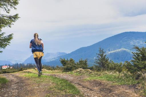 A woman running on a mountain path 9