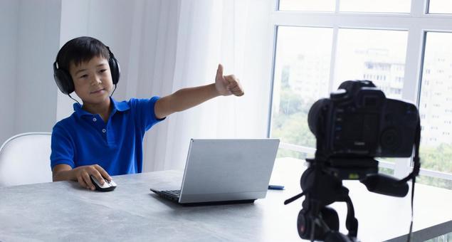Boys taking online lessons