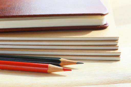 Notebook and pencil Business image material