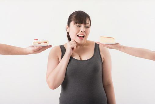 A woman surrounded by a cake 1