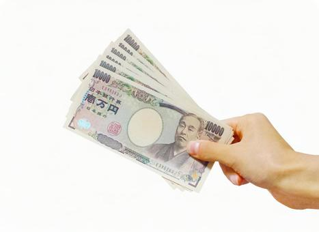 10,000 yen banknote and hand 0427