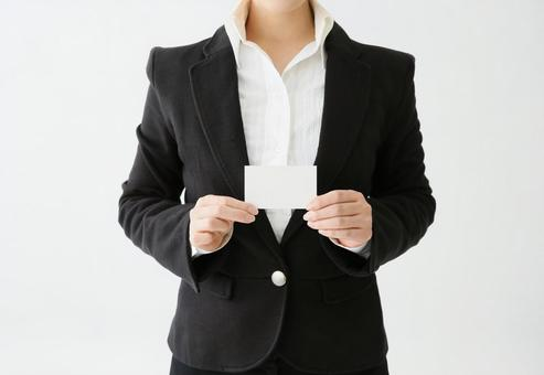 A woman with a business card (card)