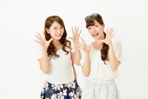 Two people girls spreading their hands 1
