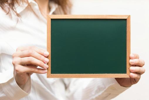 A woman with a blackboard
