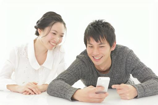 Couple watching mobile phone 2