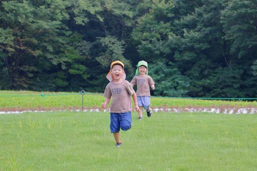 Nursery school children Children playing foot races