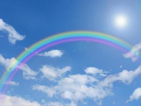 Rainbow and blue sky and sun