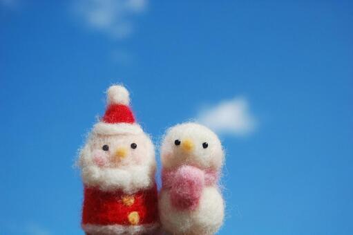 Santa and a snowman (blue sky)