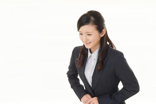 Smiley business woman bowing