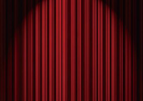 Red stage curtain in the spotlight